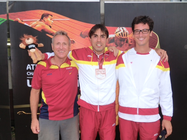 Picture of Xavi with the medal Enric and Miguel with the IPC poster at the background Lyon 2013