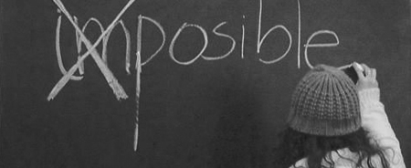 image of a girl writing on the blackboard the word impossible with the letters I and M crossed out, suggesting that, if you fight with effort, in this life anything is possible.